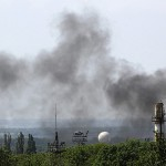 Smoke billows from Donetsk international airport during heavy fighting between Ukrainian and pro-Russian forces
